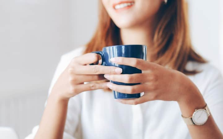 lady drinking coffee working from home