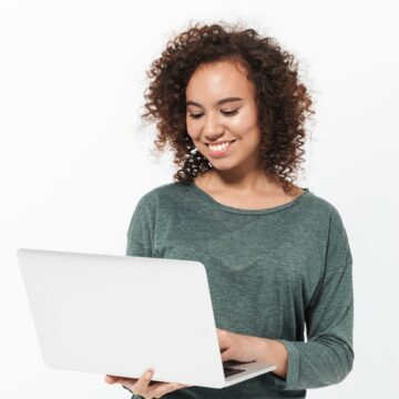 woman holding a laptop working