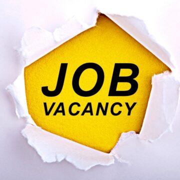 job vacancy printed on a wall
