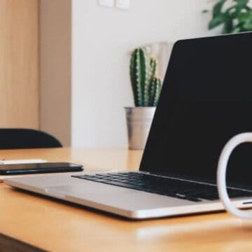 Photo of a laptop and coffee mug for remote workers for high income skills